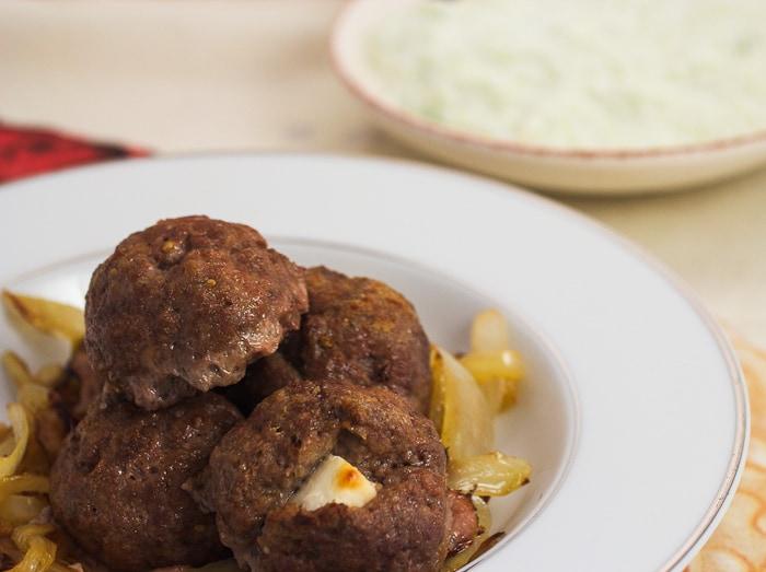 Feta Stuffed Lamb Meatballs with Onions & Tzatziki
