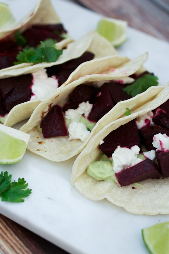 Beet and Goat Cheese Tacos with Avocado Cream from The Girl In The Little Red Kitchen