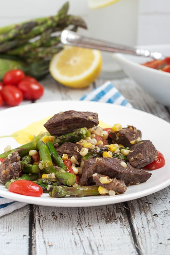 Steak Stir Fry with Asparagus, Corn and Tomatoes from The Girl In The Little Red Kitchen