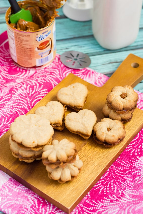 Cinnamon Dulce de Leche Spritz Sandwich Cookies #OXOgoodcookie from The Girl In The Little Red KItchen