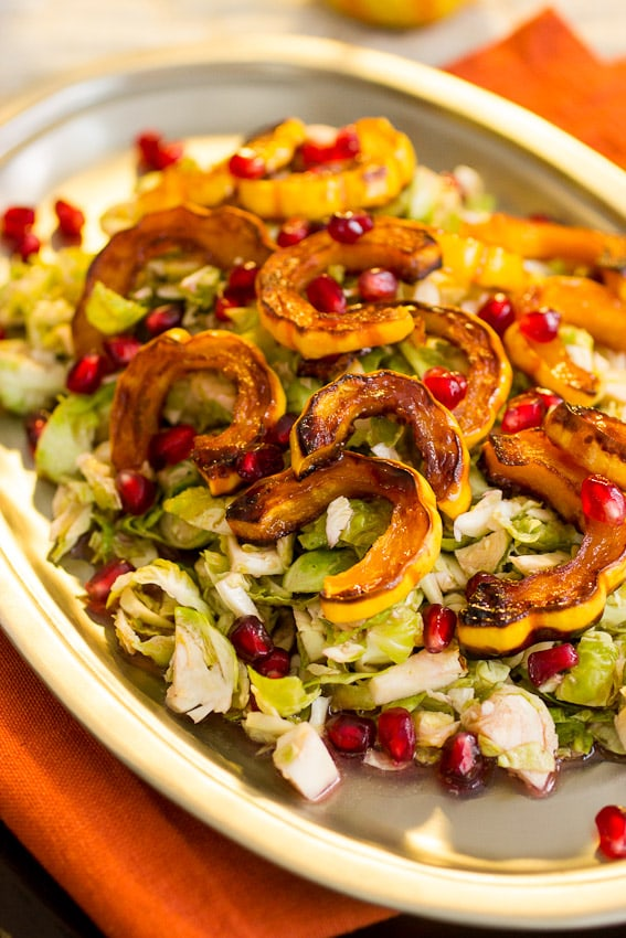 Brussels Sprouts Squash and Pomegranate Salad | girlinthelittleredkitchen.com