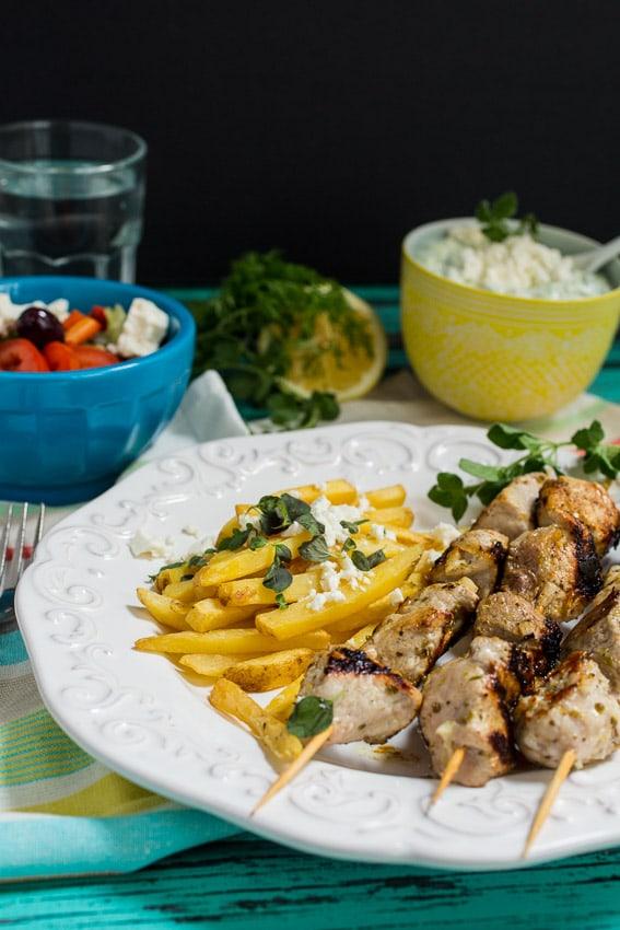 Pork Souvlaki with Greek Fries and Tzatziki Sauce | girlinthelittleredkitchen.com