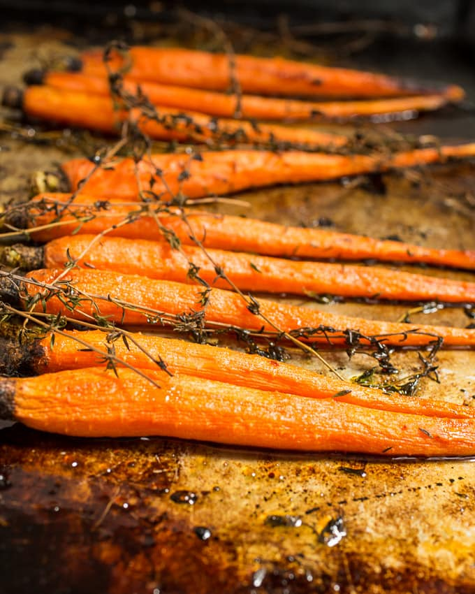 Hot Honey Thyme Roasted Carrots | girlinthelittleredkitchen.com