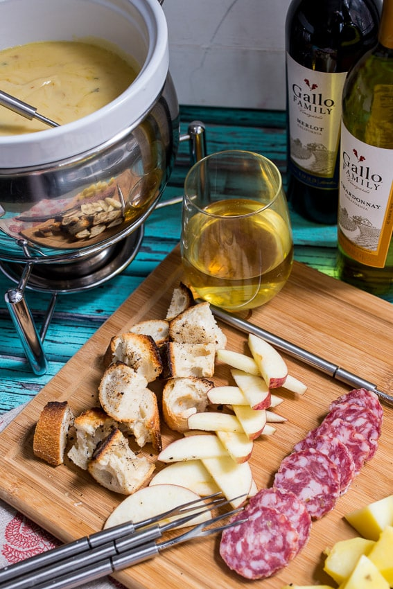 Roasted Garlic Cheese Fondue #SundaySupper | girlinthelittleredkitchen.com