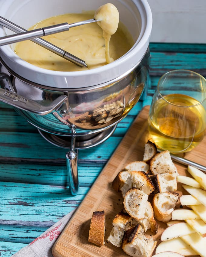Roasted Garlic Cheese Fondue | girlinthelittleredkitchen.com