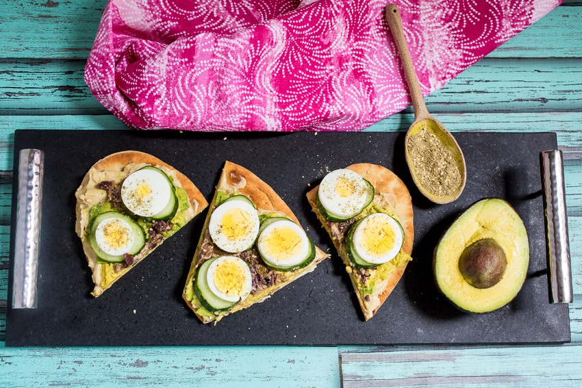 Avocado Egg and Cucumber Hummus Toast | girlinthelittleredkitchen.com