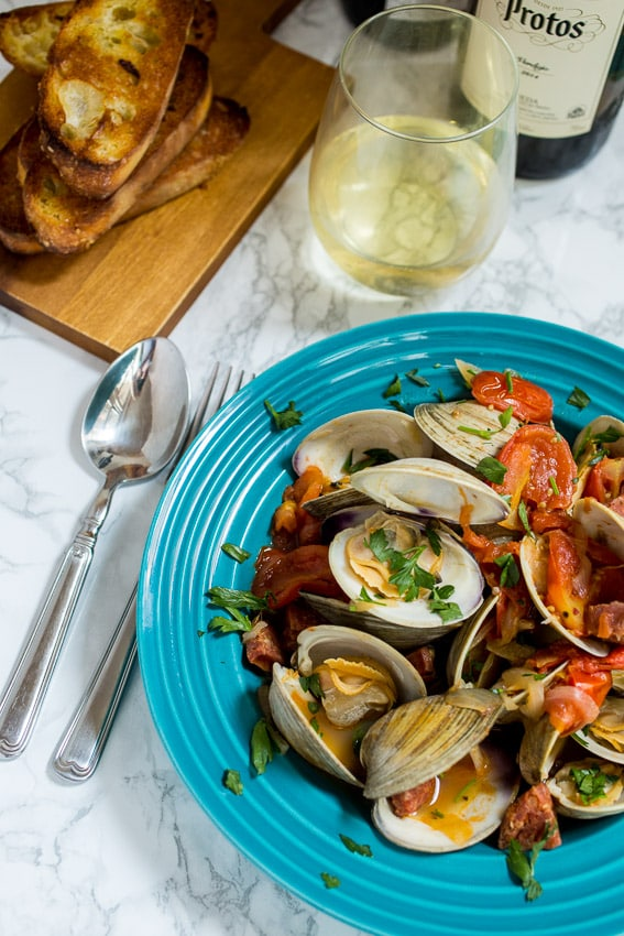 Steamed Clams with Chorizo and Tomatoes from The Girl In the Little Red Kitchen