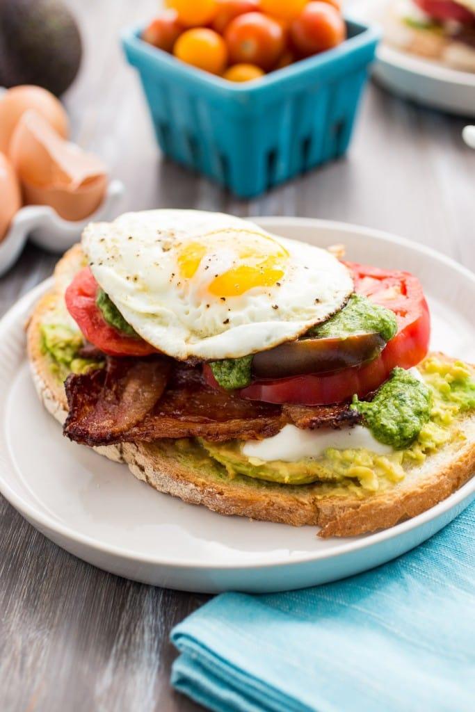 Avocado Bacon Caprese Breakfast Sandwich | girlinthelittleredkitchen.com