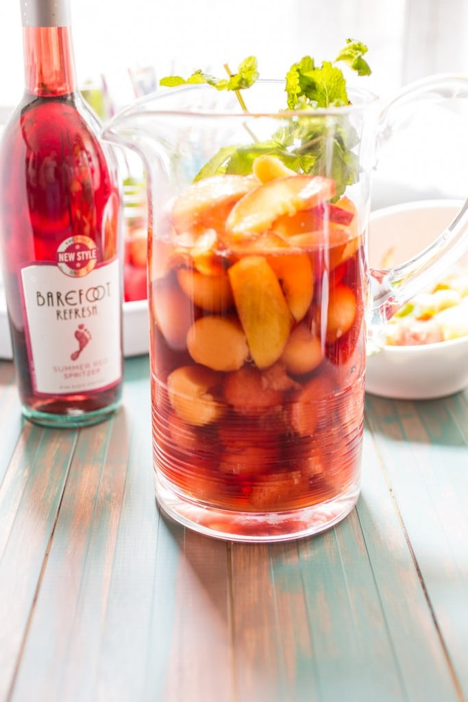 Spiked Peach and Melon Punch | girlinthelittleredkitchen.com