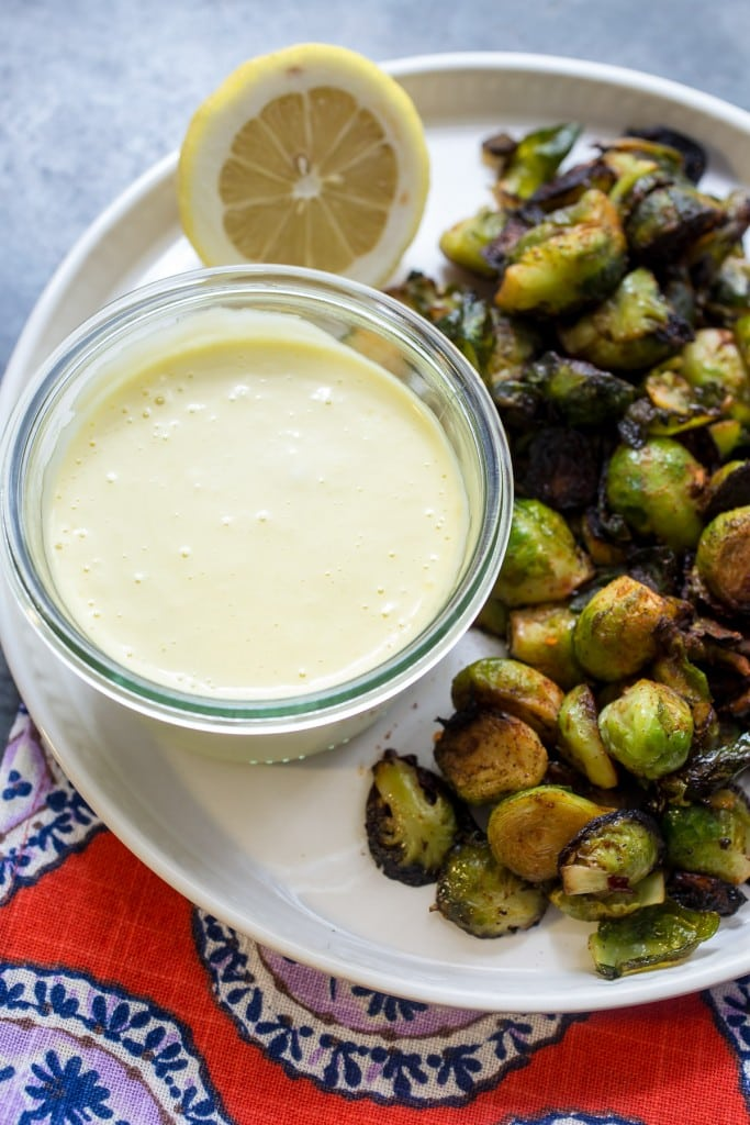 Harissa Brussels Sprouts with Lemon Garlic Aioli | girlinthelittleredkitchen.com