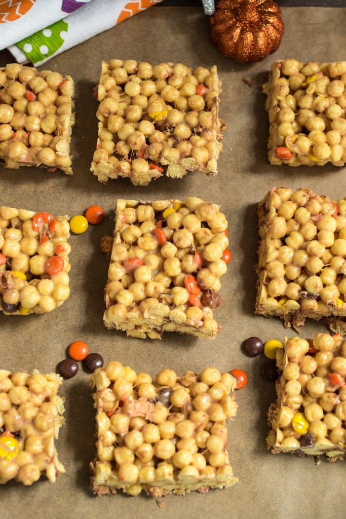 Reese's Marshmallow Cereal Bars from The Girl In The Little Red Kitchen | Filled with peanut butter Halloween candy and puffed peanut butter cereal, these no-bake bars are perfect to use up extra Halloween candy!