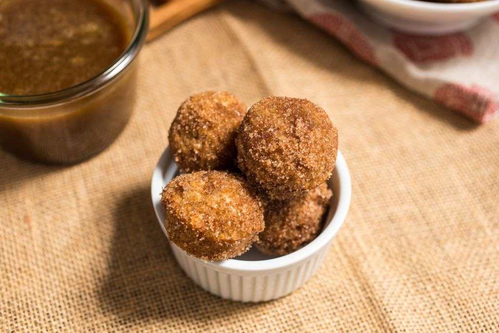 Apple Cider Donut Holes with Hot Buttered Rum Dipping Sauce |girlinthelittleredkitchen.com