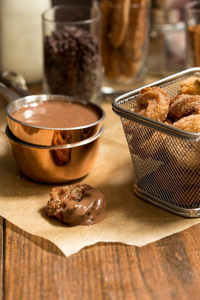 Churro Bites with Spicy Chocolate Sauce | girlinthelittleredkitchen.com