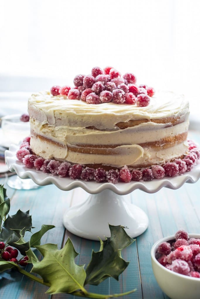 Cranberry Champagne Cake from The Girl In The Little Red Kitchen | Champagne scented and filled with cranberry this cake will be the shining centerpiece of any table.