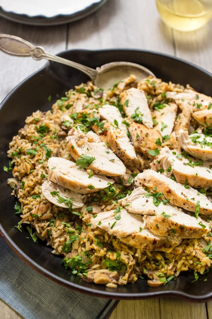 Chicken Mushroom Rice Skillet from The Girl In The Little Red Kitchen | Easy, healthy, flavorful and comforting one-pot meal that's sure to go into your dinner rotation.