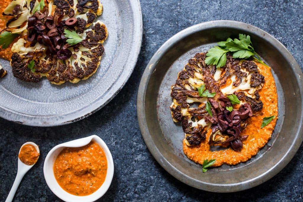 Cauliflower Steaks with Spicy Romesco Sauce | girlinthelittleredkitchen.com