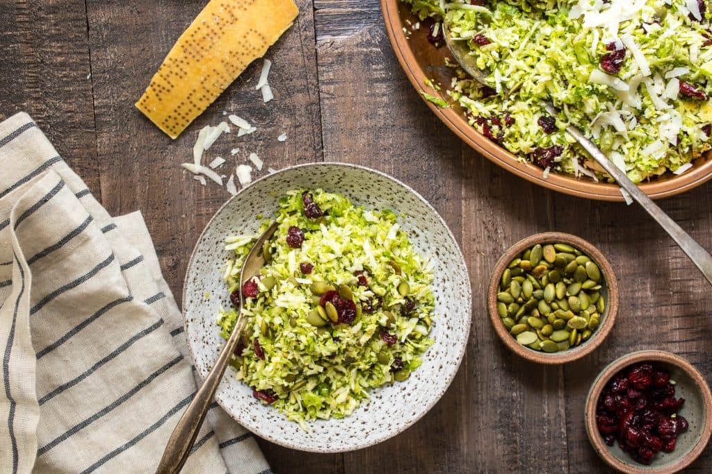 Brussel Sprouts Salad with Cranberries, Pepitas and Parmesan | girlinthelittleredkitchen.com
