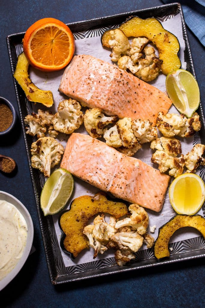 Sheet Pan Salmon with Garam Masala Squash and Cauliflower | girlinthelittleredkitchen.com