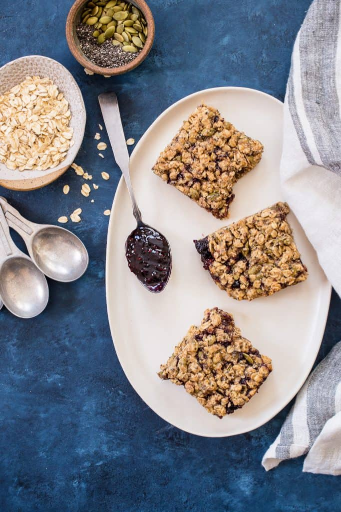 Soft and Chewy Baked Oatmeal Bars with Almond Butter and Jam | girlinthelittleredkitchen.com