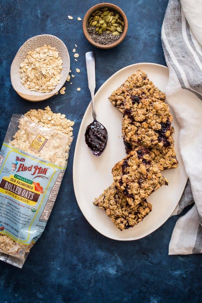 Vegan Oatmeal Breakfast Bars | girlinthelittleredkitchen.com