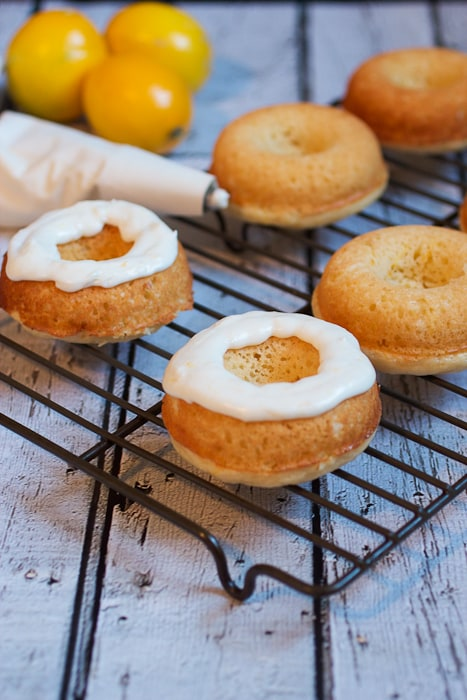 Meyer Lemon Donuts topped with meyer lemon buttercream from The Girl In The Little Red Kitchen