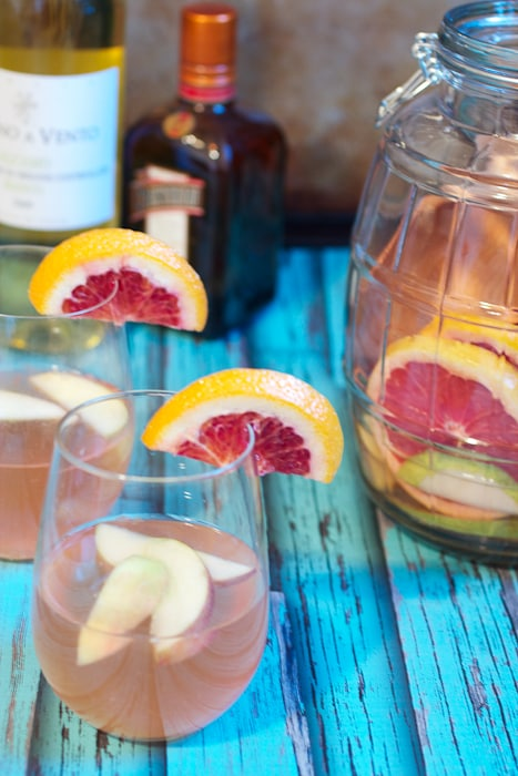Winter Fruit White Wine Sangria- an easy and refreshing seasonal fruit cocktail from The Girl In The Little Red Kitchen