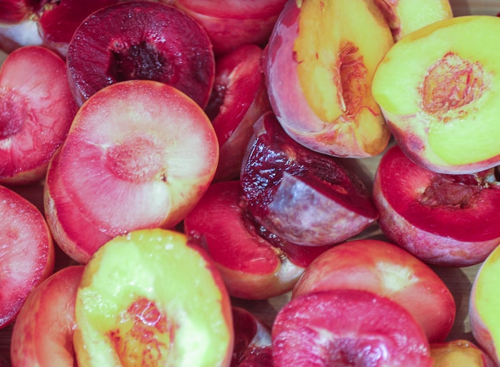 Peaches and Pluots prepped for a crisp | girlinthelittleredkitchen.com