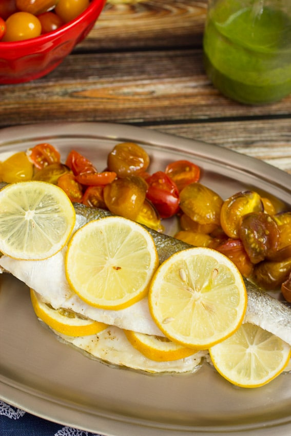 Roasted Branzino and Tomatoes with Lemon Basil Sauce- The Girl In The Little Red Kitchen