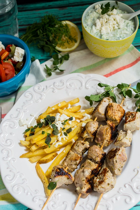 Pork Souvlaki with Greek Fries and Tzatziki Sauce from The Girl In The Little Red Kitchen
