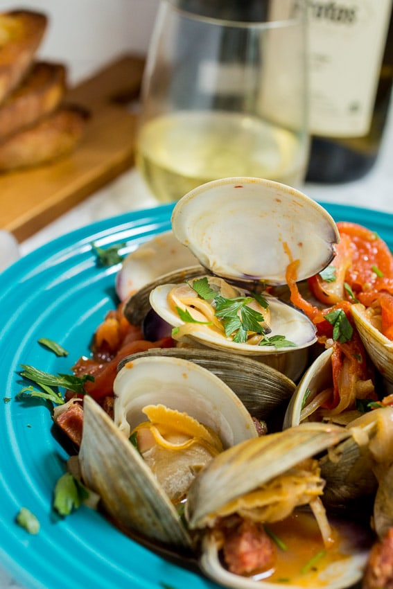 Steamed Clams with Chorizo and Tomatoes | girlinthelittleredkitchen.com
