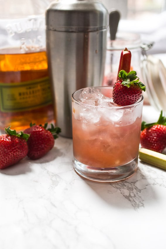 Strawberry Rhubarb Whiskey Smash shaken in a flash with homemade compote from The Girl In The Little Red Kitchen