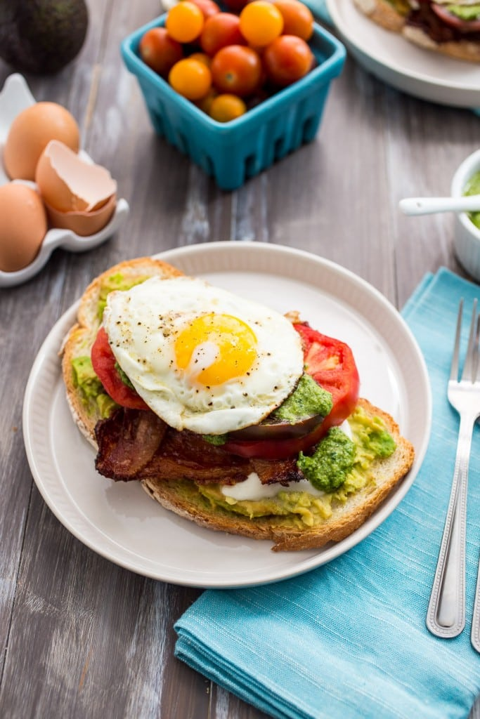 Avocado Bacon Caprese Breakfast Sandwich | girlinthelittleredkitchen.com