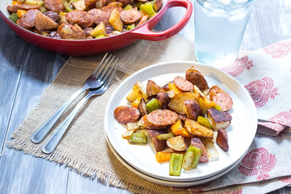 Cajun Potato and Andouille Sausage Bake | girlinthelittleredkitchen.com