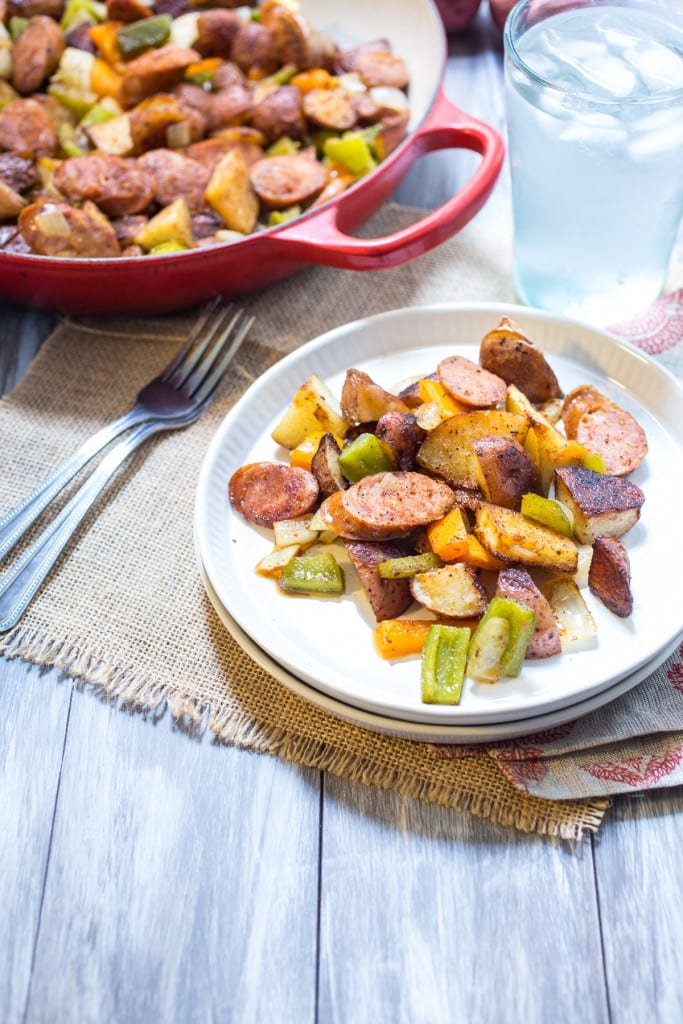 Cajun Potato and Andouille Sausage Bake from The Girl In The Little Red Kitchen | A no-fuss, on sheet pan dinner that's a set it and forget it type meal.