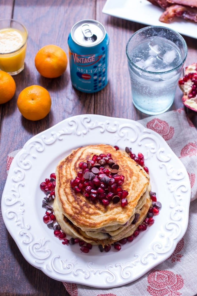 Chocolate Chip Pomegranate Pancakes from The Girl In The Little Red Kitchen | Light and fluffy pancakes made with seltzer water and topped with fresh pomegranates and chocolate chips.