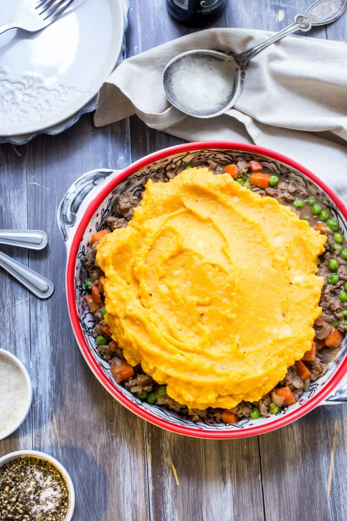 Butternut Squash Shepherd's Pie from The Girl In The Little Red Kitchen | Traditional shepherd's pie gets topped with sweet butternut squash and potatoes for a new twist on an old classic.