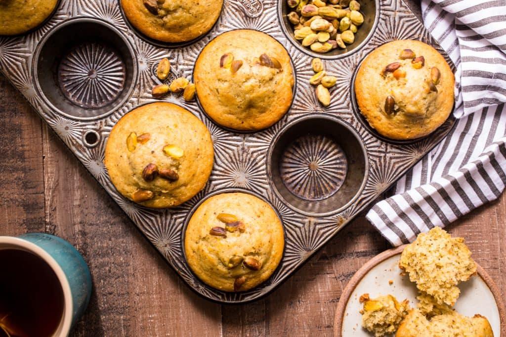 Pistachio Cardamom Muffins | girlinthelittleredkitchen.com