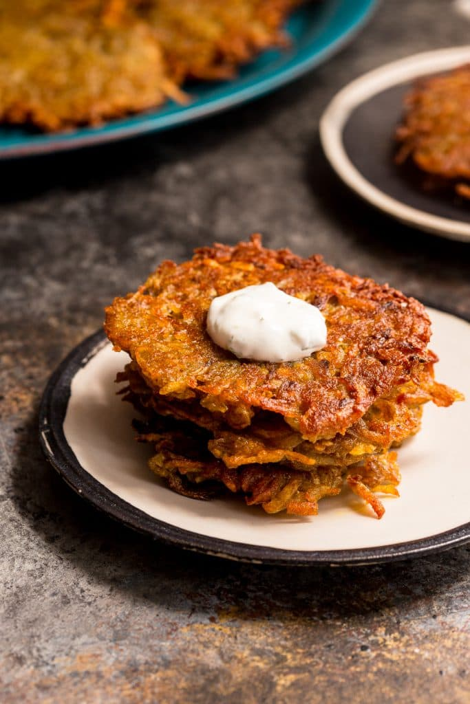 Tikka Masala Latkes with Mint Yogurt Sauce | girlinthelittleredkitchen.com