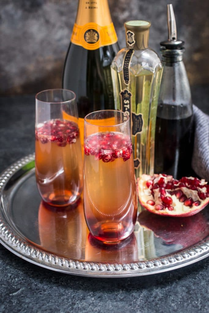 St. Germain and Pomegranate Champagne Cocktail | girlinthelittleredkitchen.com